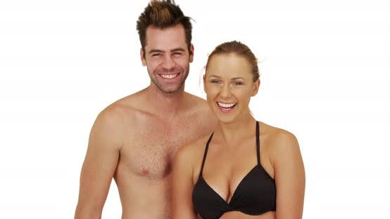 Thumbnail for Attractive Caucasian millennial couple standing at the beach smiling at camera