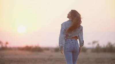 Girl with Long Hair and Jeans