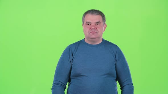 Thumbnail for Man Is Not Emotional Standing in the Studio. Green Screen. Slow Motion