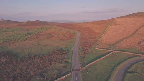 Car driving through Dartmoor National Park, Devon, England, UK, Aerial drone view