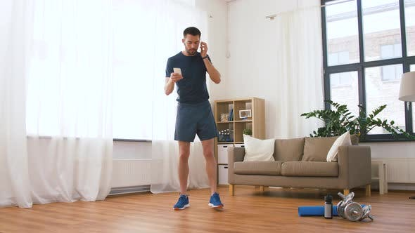 Thumbnail for Man with Wireless Earphones Exercising at Home