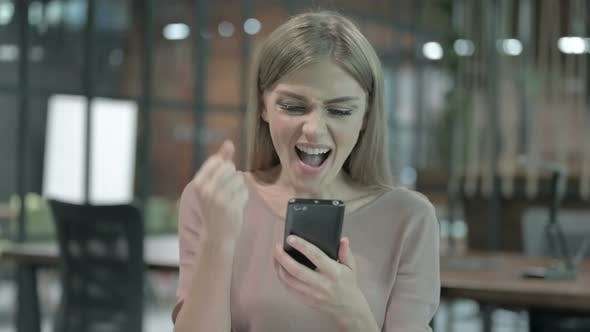 Thumbnail for Portrait Shoot of Success Woman Celebrating on Smartphone