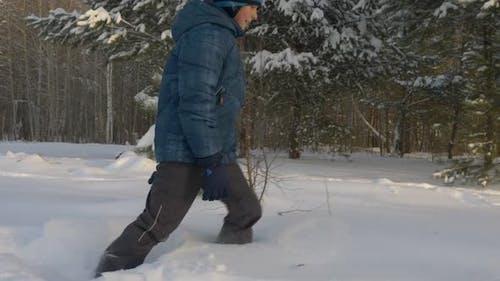 Caucasian White Boy Walk By Snow Drift Winter Park Outdoors