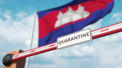 Opening Barrier with QUARANTINE Sign at the Flag of Cambodia