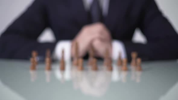 Cover Image for Man Moving Pawn in Chess Game, Involving Voters in Unfair Political Strategy