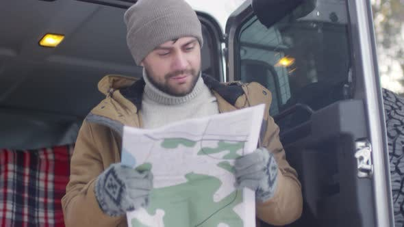 Thumbnail for Tourist with Map in Forest