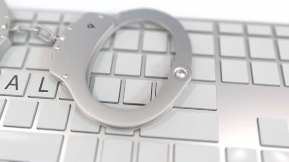 Thumbnail for Handcuffs on Keyboard with ILLEGAL Text on Keys