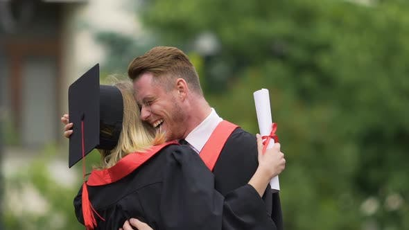 Thumbnail for Excited Male and Female University Graduates Exchanging Congratulations, Hugging
