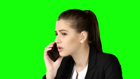 Cover Image for Brunette Businesswoman Hanging the Phone Angry. Green Screen