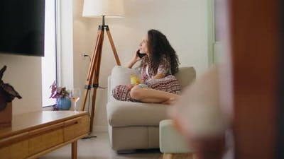 Woman talking on the phone at home