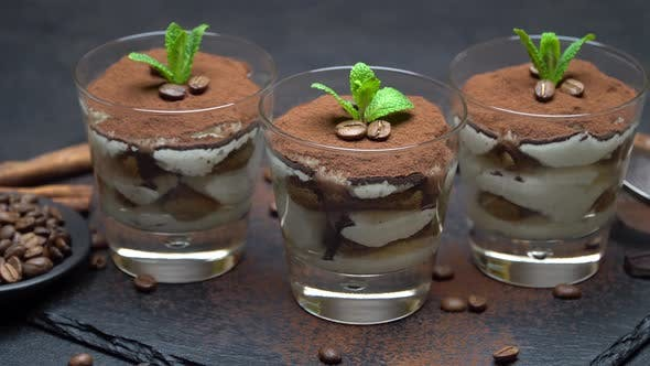 Thumbnail for Classic Tiramisu Dessert in A Glass on Stone Serving Board on Dark Concrete Background