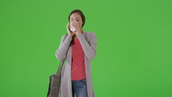 Thumbnail for A Latina woman talks to her friends on the phone on green screen