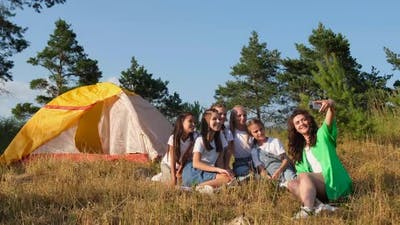 Group of Schoolchildren with a Teacher with Tents in Nature