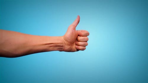 Thumbs Up Gesture On Blue background