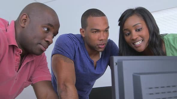 Thumbnail for Black business team looking at sales data on a computer