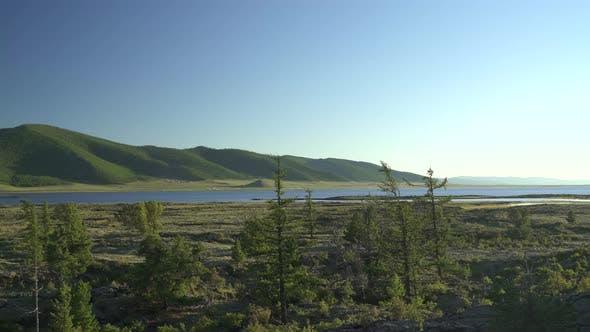 Thumbnail for A Lake Among Tree Branches and Rocks