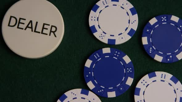 Rotating shot of poker cards and poker chips on a green felt surface - POKER 038