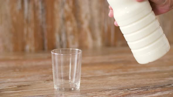 Thumbnail for Female Hand Pouring Milk From Bottle To Glass