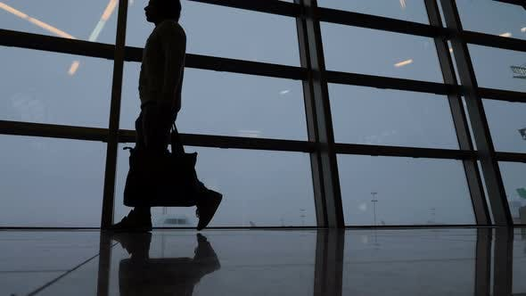 Thumbnail for Silhouette of Male Passenger Walking at Airport