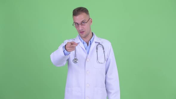 Thumbnail for Happy Handsome Man Doctor Pointing at Camera