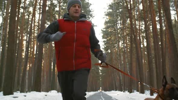 Thumbnail for Active Man Jogging with Dog in Winter
