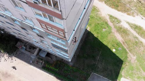 Industrial Climber Painting Building Facade Wall, Insulation Work, Aerial View