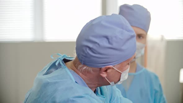 Thumbnail for Surgeon Operating with Assistant