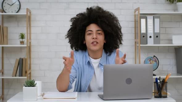 African Teacher Guy At Laptop Talking Having Online Class Indoors