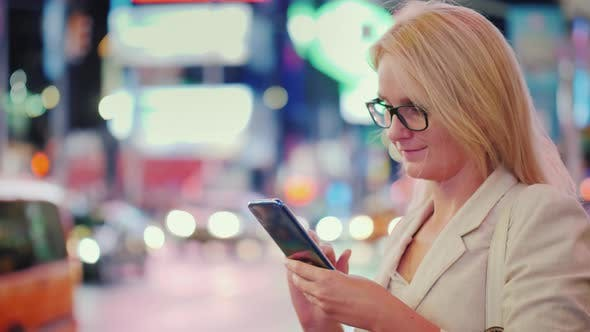 Thumbnail for Business Woman Uses a Smartphone on Busy Times Square in New York