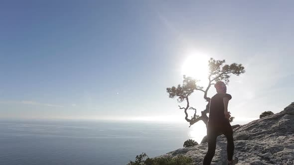 Young Woman Walking and Running on a Mountain. Lady on the Summit in Beautiful Scenery Facing the