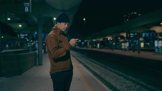 Thumbnail for Midnight Commuter Wait for Train on Dark Platform