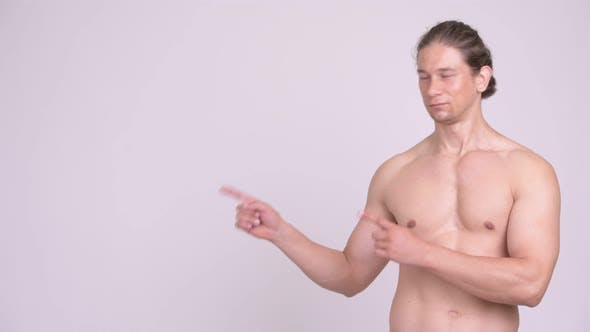 Thumbnail for Happy Muscular Shirtless Man Pointing Fingers While Showing Something