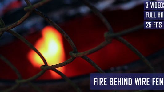 Thumbnail for Fire In Barrel Behind Wire Fence