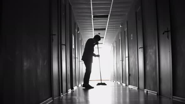 Thumbnail for Silhouette of Cleaner Sweeping Floor