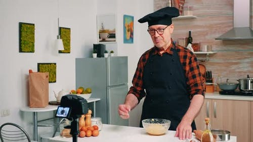 Vlogger Recording Cooking Related Broadcast