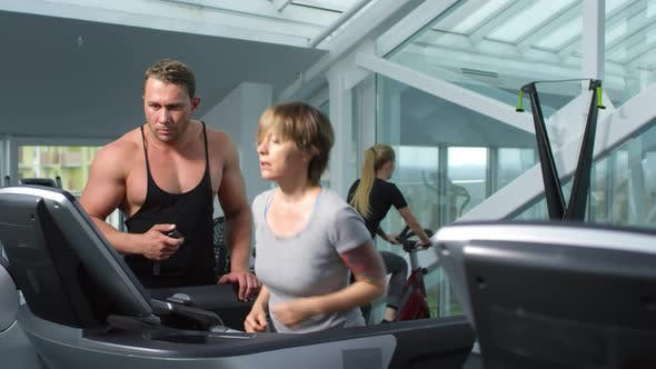 Thumbnail for Active People Using Exercise Machines