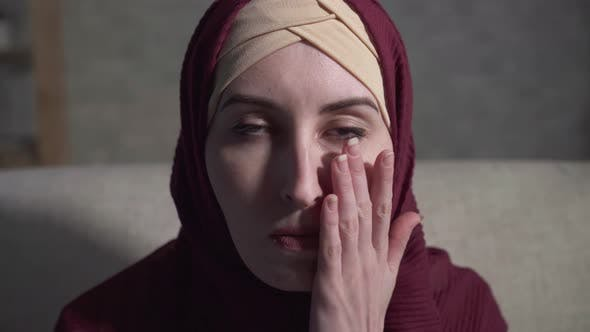 Portrait of a Crying Young Muslim Woman