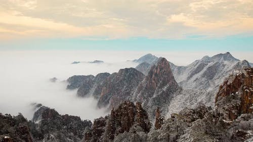 Sunrise time lapse of fog at the Yellow Mountains in China
