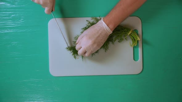 Thumbnail for Chef Cook Cutting Dill on a White Board