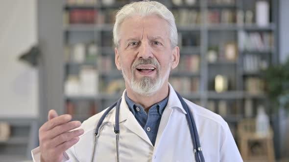 Senior Old Doctor Doing Video Chat