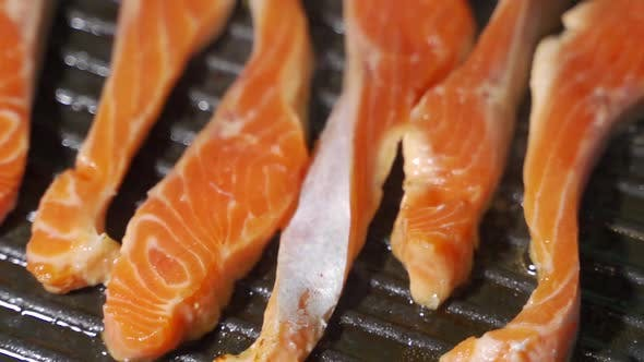 Cover Image for Grilling Salmon Fillet on Smoking Grill. Close Up Salmon Fillet Barbecuing on Charcoal Grill.