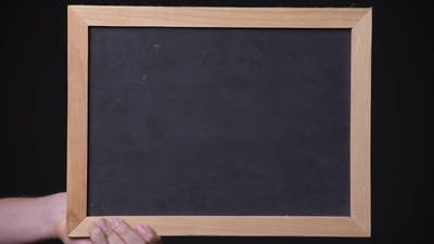 Hand of Young Man Showing Blackboard