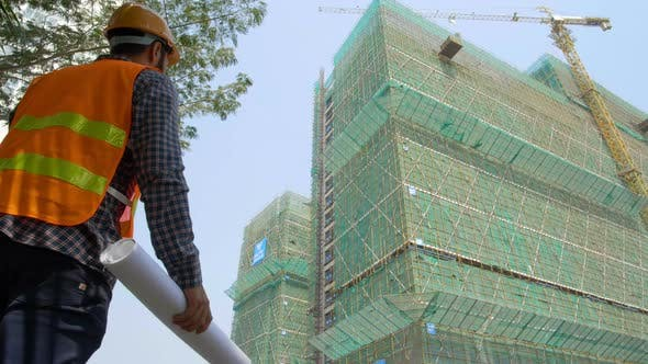 Thumbnail for Engineer Looking at Constructing Building