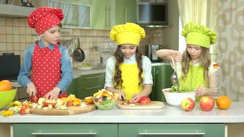 Three Kids Making Salad.