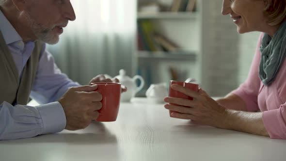 Thumbnail for Aged Man and Woman Talking Over Cup of Tea at Table, School Sweethearts, Meeting