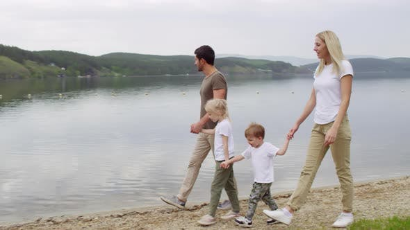 Family of Four Walking by the Lake