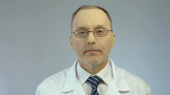 Thumbnail for Experienced Look of Serious Male Physician, Professional Medical Aid at Clinic