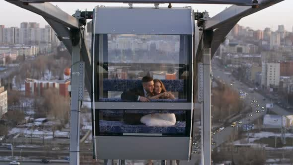 Thumbnail for Loving Couple Riding Ferris Wheel