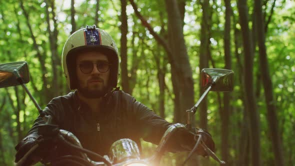 Thumbnail for Riding a motorcycle near a forest