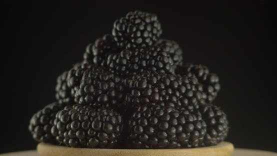 Thumbnail for Ripe Blackberries on A Plate Rotate on A Black Background